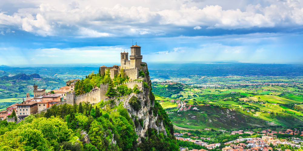 medieval Guaita first tower on a rocky cliff and panoramic view of Romagna