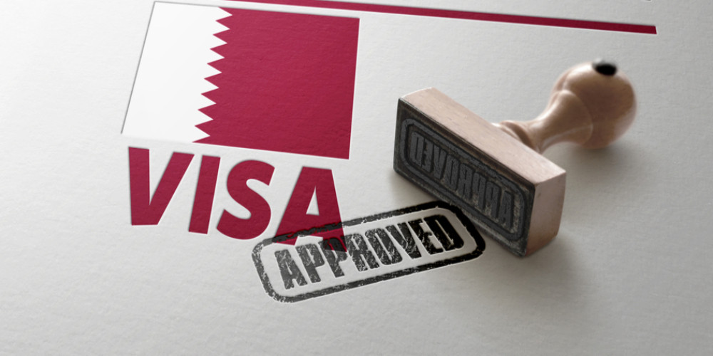 Qatar Visa Approved with Rubber Stamp and national flag