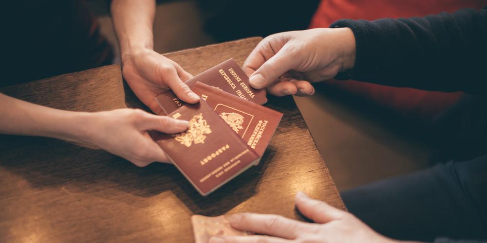 Woman giving passports
