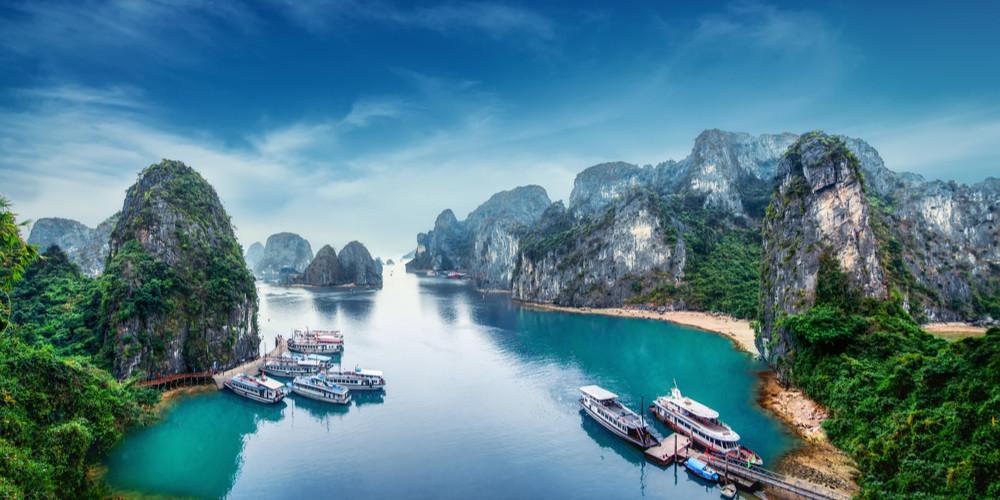 Tourist scraps floating among limestone rocks in Ha Long Bay, Vietnam