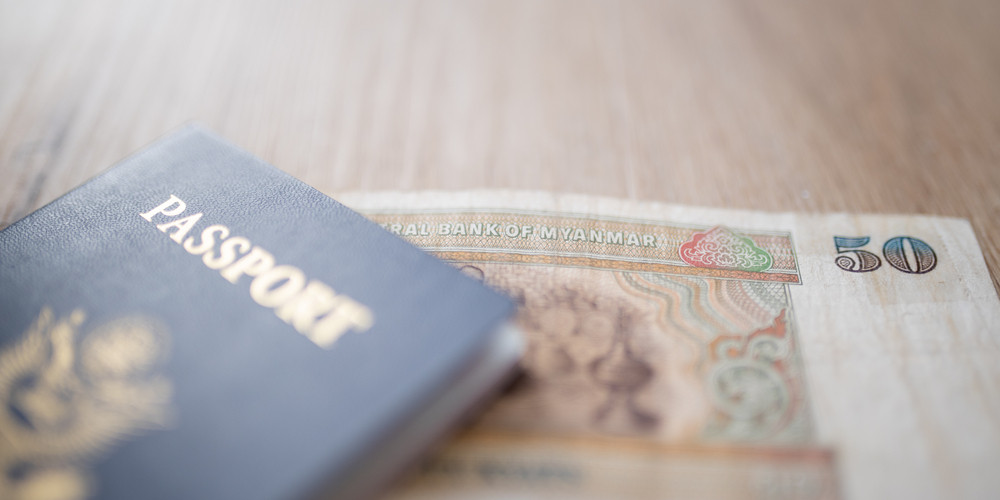 Picture of a blurry United States of America Passport with a Fifty Burmese Kyats