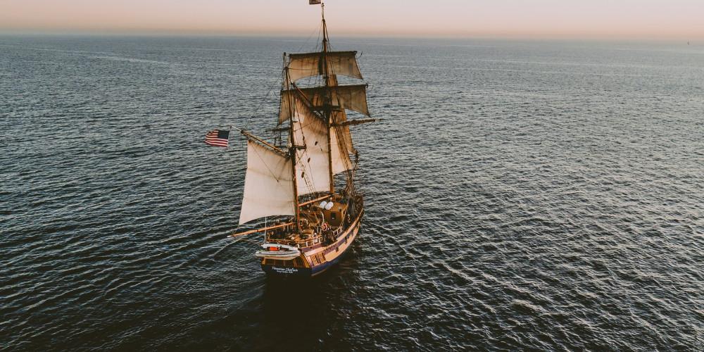 Brown sailboat in beach