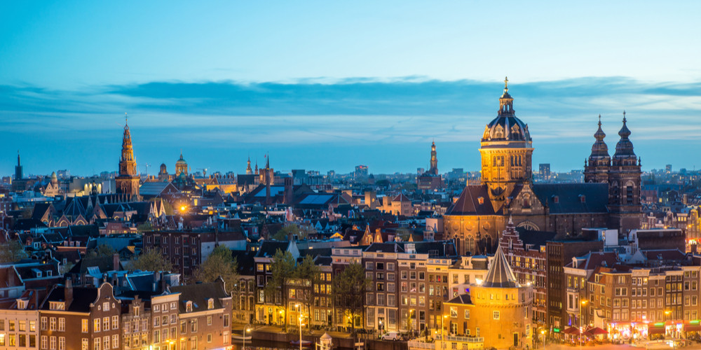 Skyline at historical site at night, Amsterdam, Netherlands