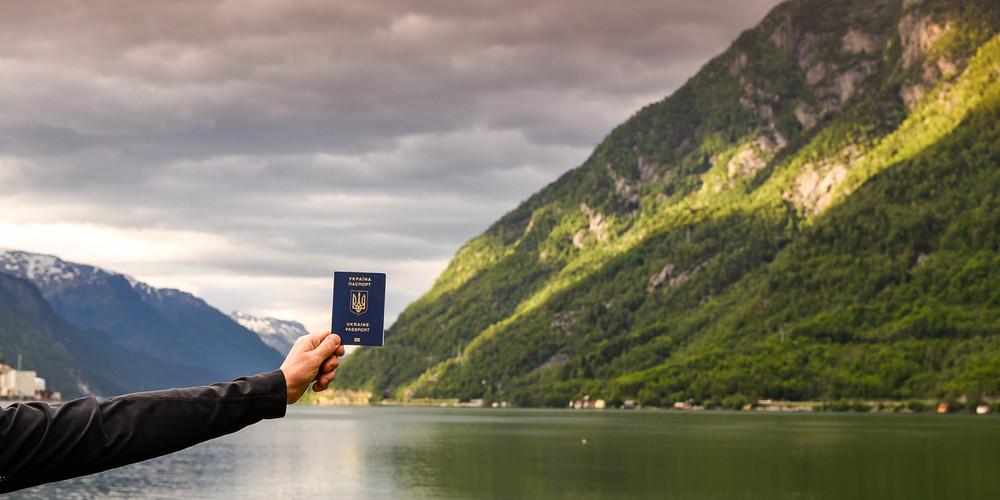 Man holding Ukrainian passport, Norway