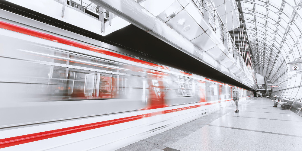 Blurred motion of illuminated railroad station