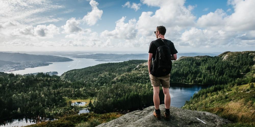 Backpacker standing on rock