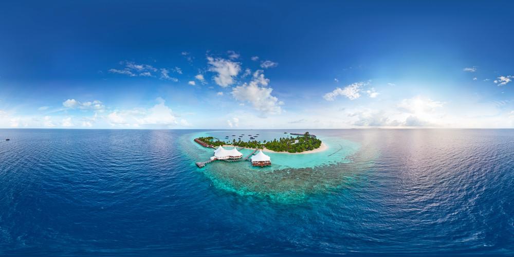 Aerial spherical panorama of tropical paradise beach on tiny Maldives island