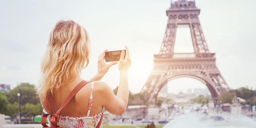 Tourist visiting landmark Eiffel Tower in Paris