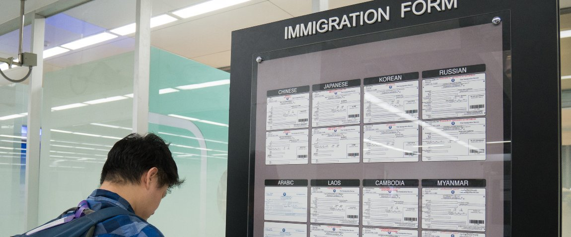 asian man traveler filling form