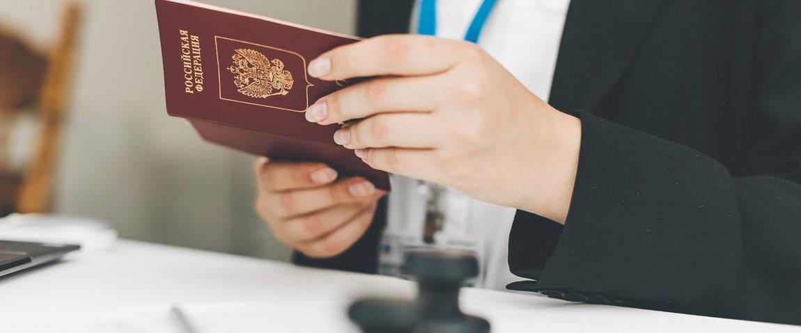 visa officer puts a stamp
