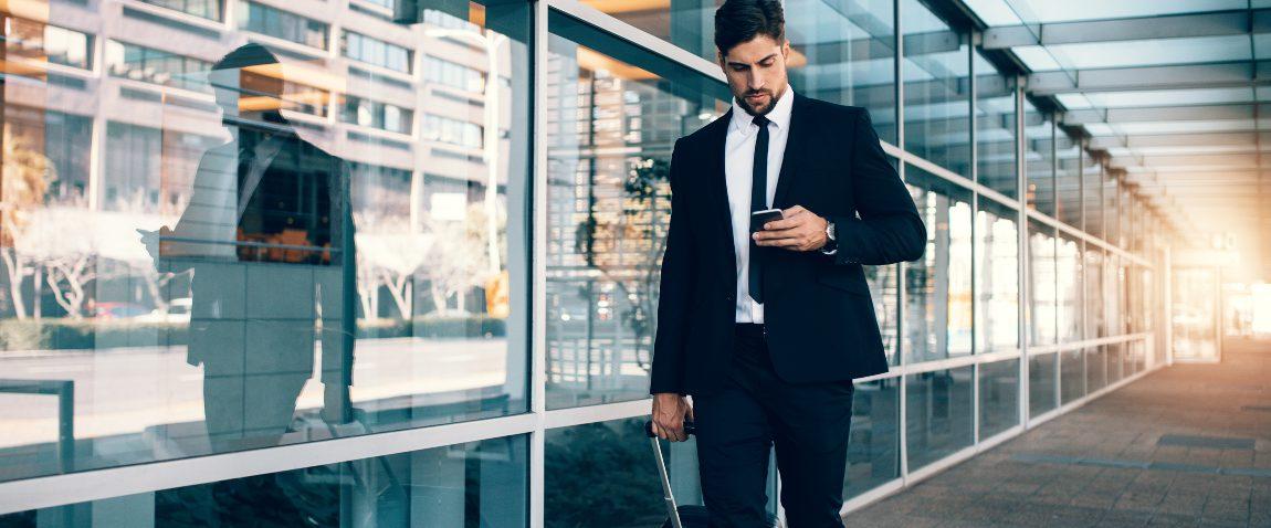businessman walking with luggage
