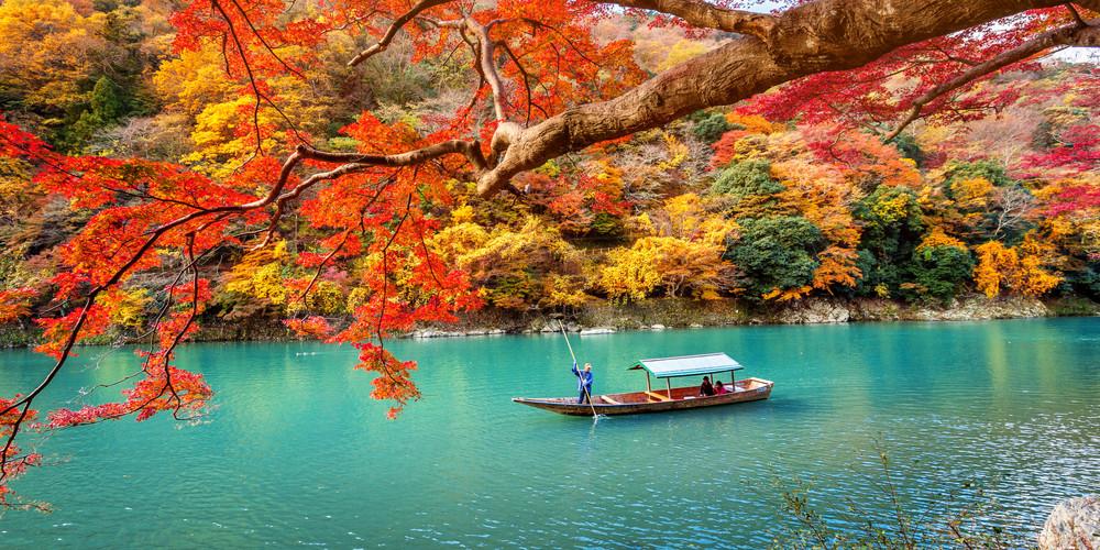 Arashiyama during the autumn season along the river in Kyoto, Japan