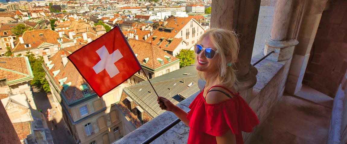 blonde woman holding flag