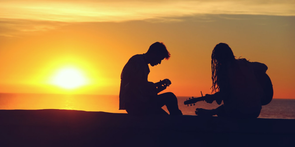 Playing guitars on the beach