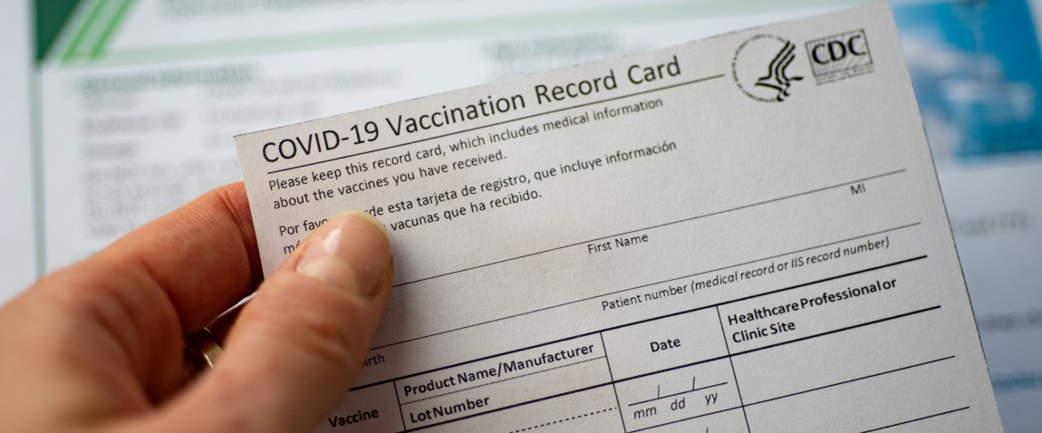 closeup view of covid vaccination card