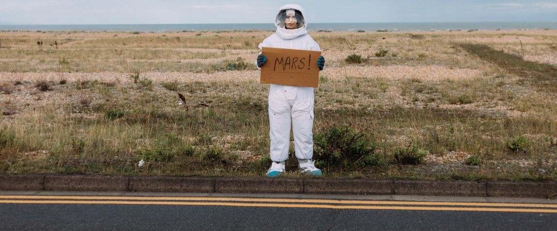 cosmonaut with box