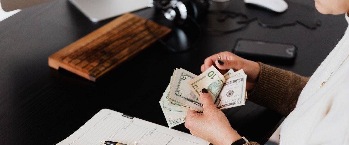 entrepreneur counting money