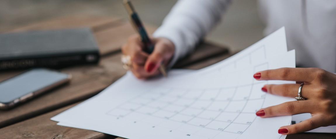 woman filling calendar