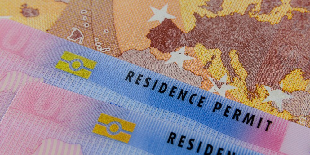Residence Permit cards and a map of the EU on the Euro banknote