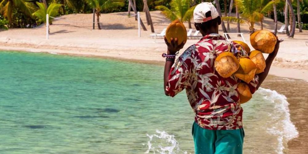 Coconut saler in the famous Juan Dolio Beach