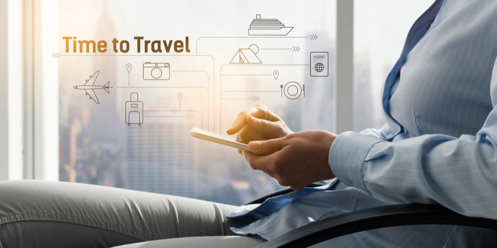 Woman booking her vacation online using a travel app