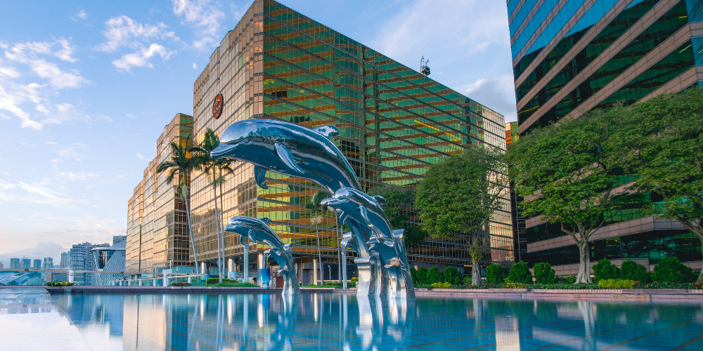 Three blue dolphins statue near hotels