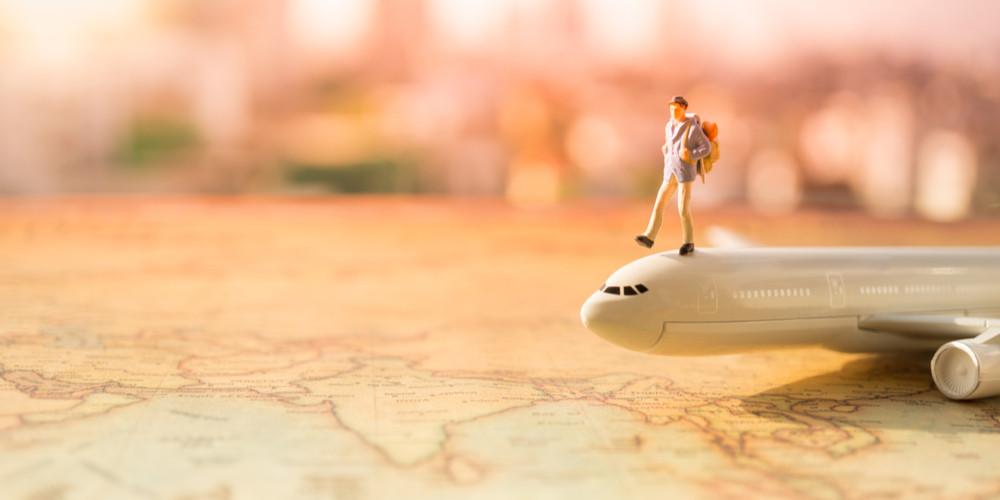 Miniature traveller on airplane