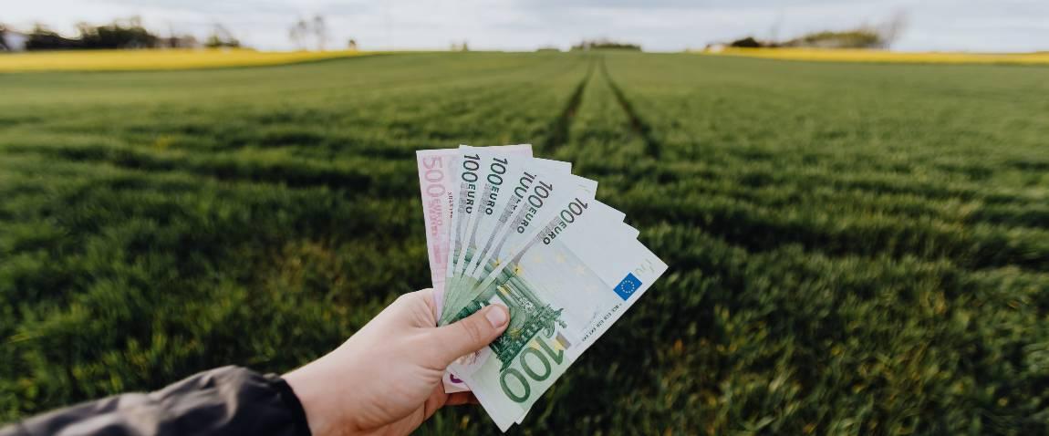 farmer showing money