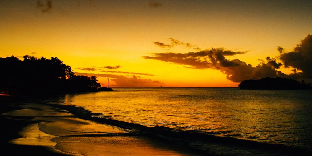 Golden sunset on the shoreline of Halcyon Bay, Saint Lucia