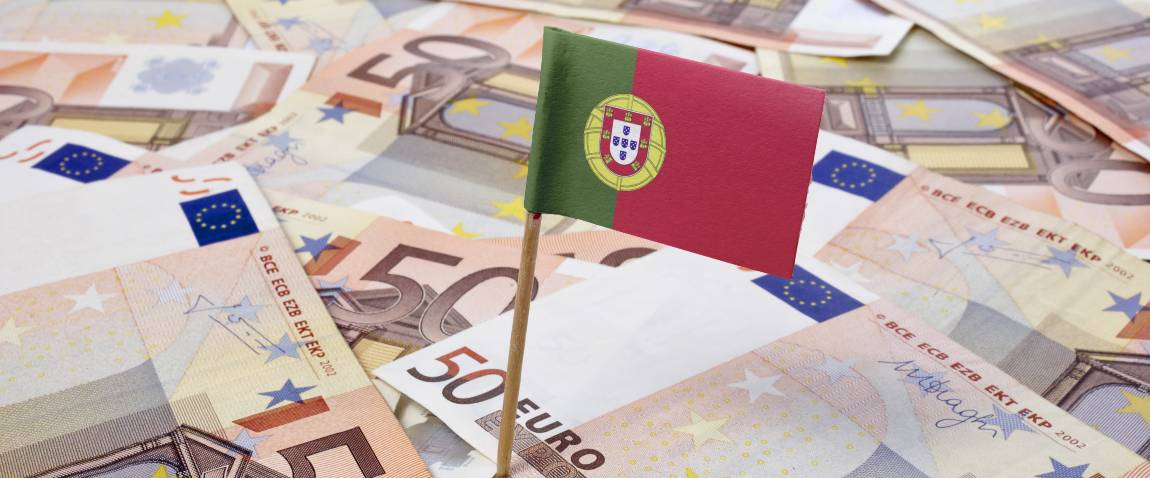 flag of portugal sticking in european banknotes