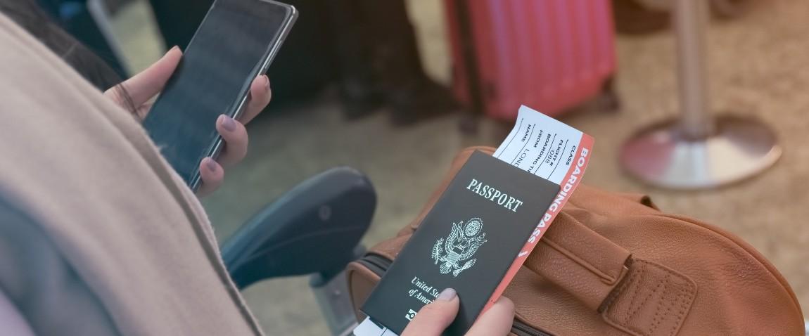 girl holding phone and passport