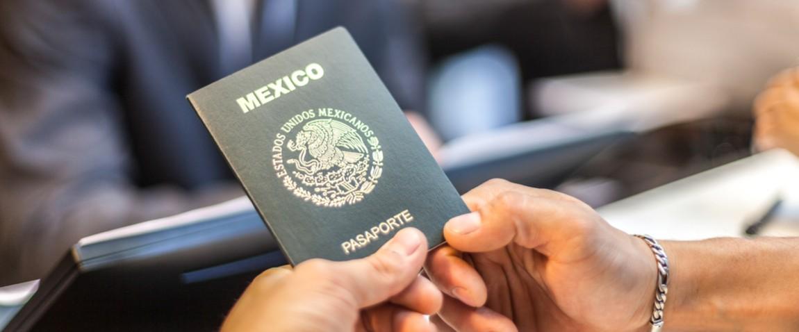 man holding mexico visa