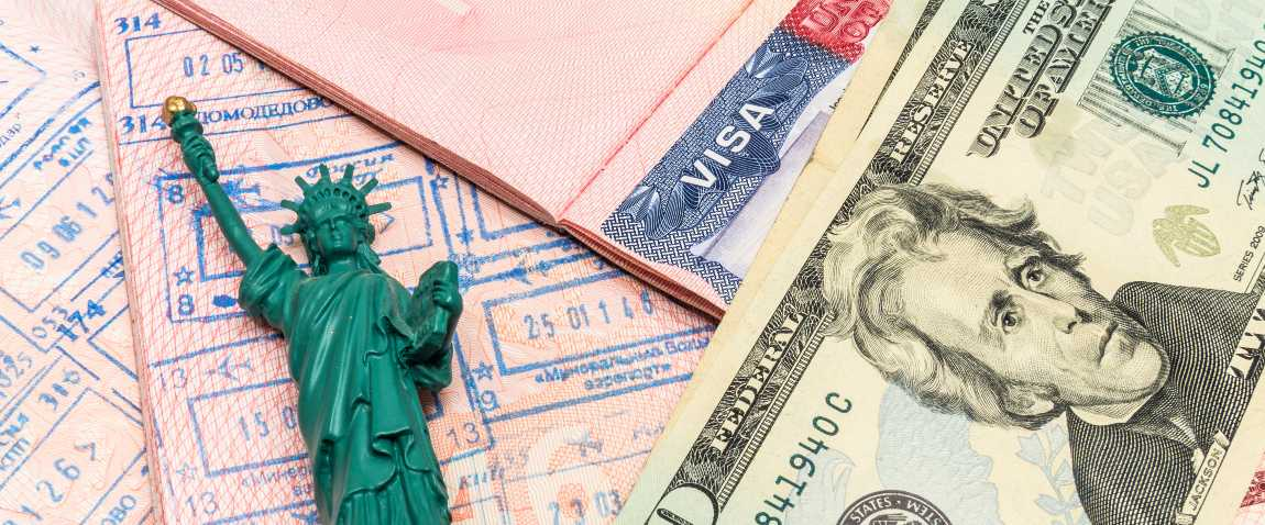 passport and small statue of liberty