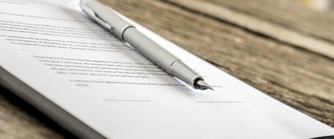 pen lying on contract