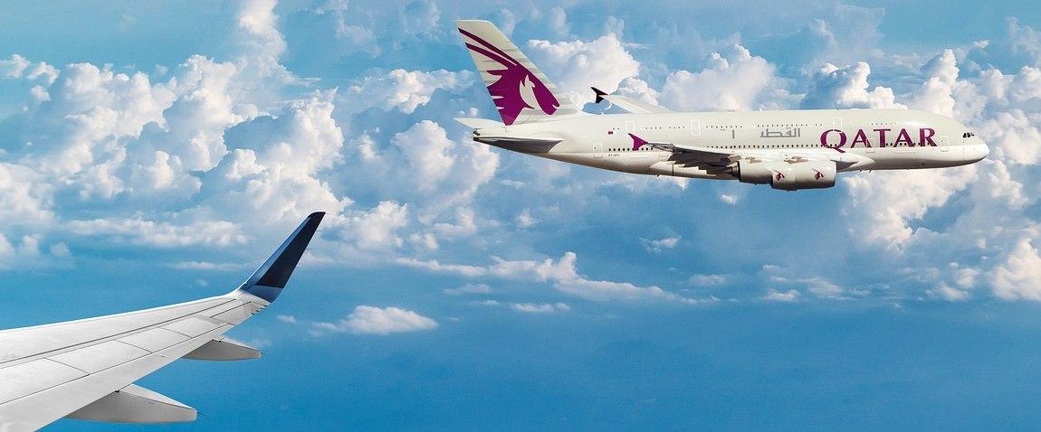 qatar airways airplane on the sky