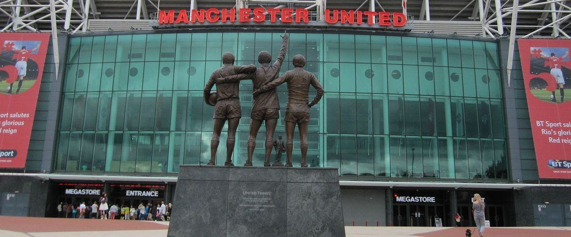 sculptures in front of old trafford