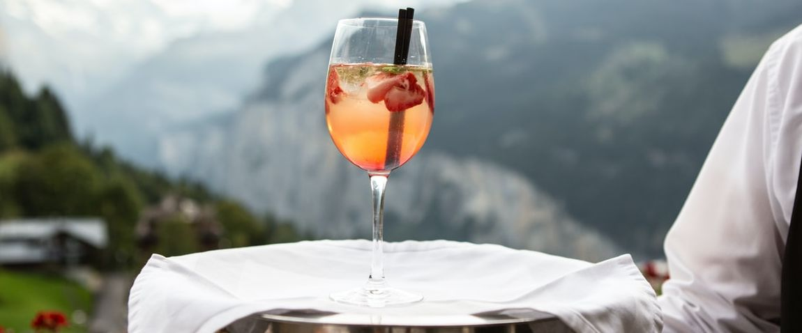 serving a glass of cocktail