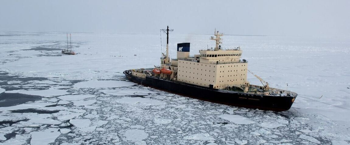 ship floating in iced water