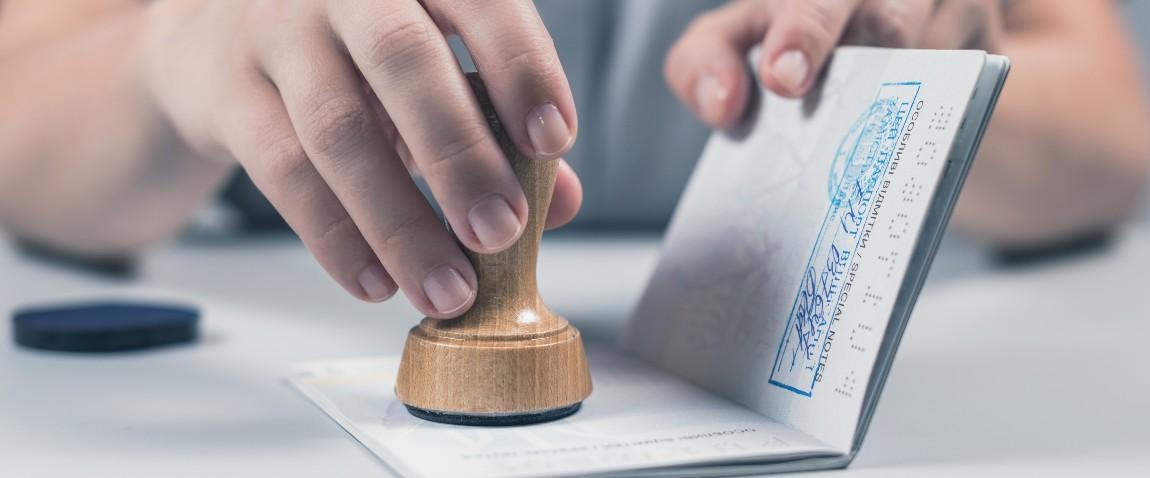 stamping passport after checking