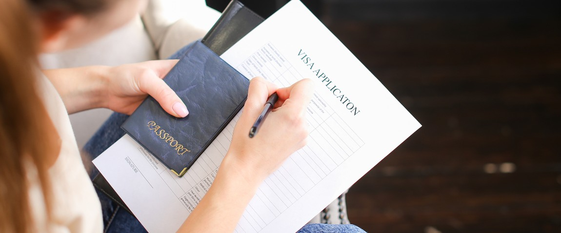 student filling visa application form