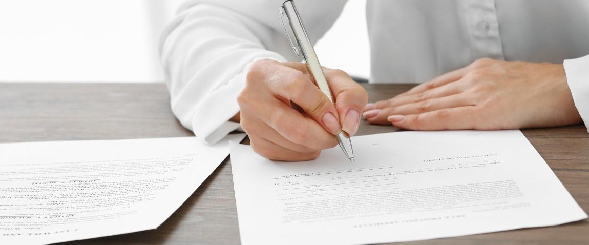 businesswoman signing