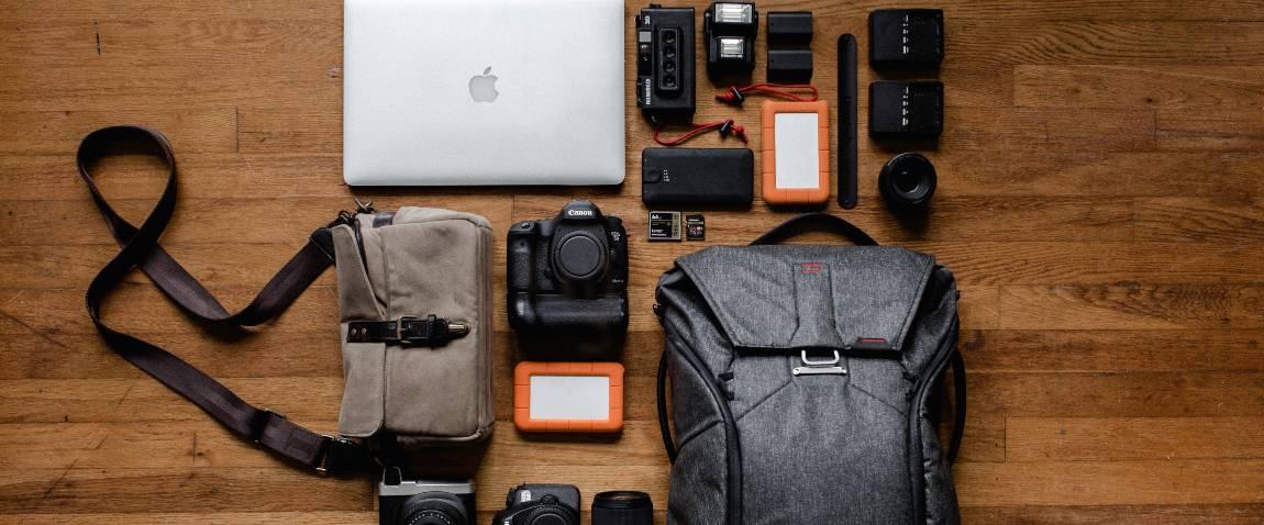 top view photo gadgets on hardwood floor
