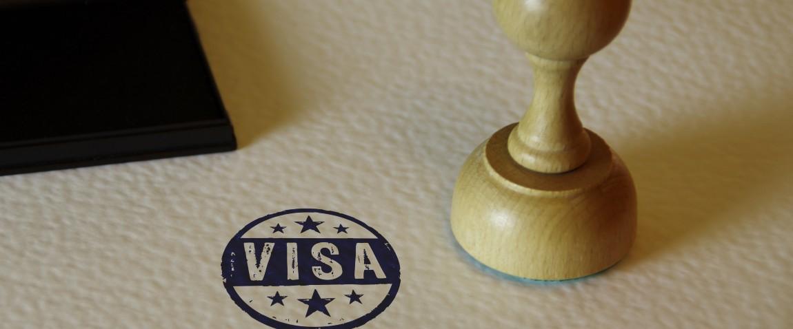 visa stamp and stamping hand