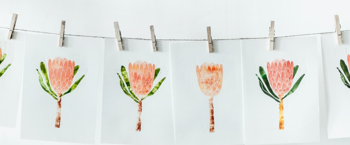 white paper with orange flower