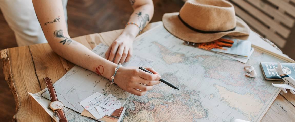 woman checking a world map