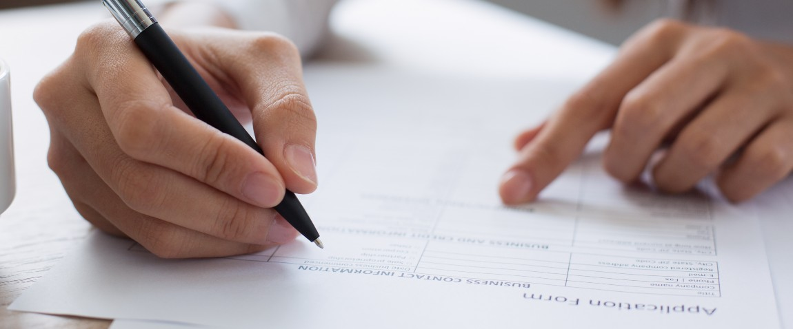 woman completing application form