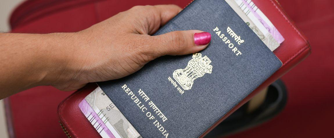 holding blue passport