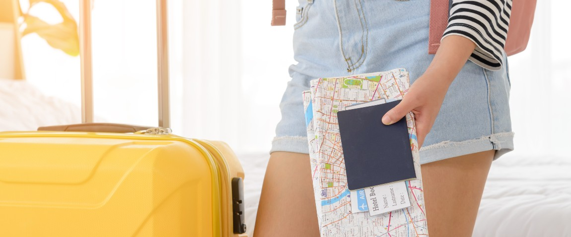 woman holding map and passport