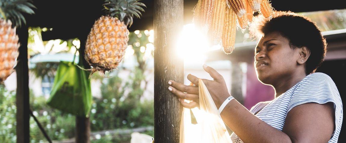 woman buying corn